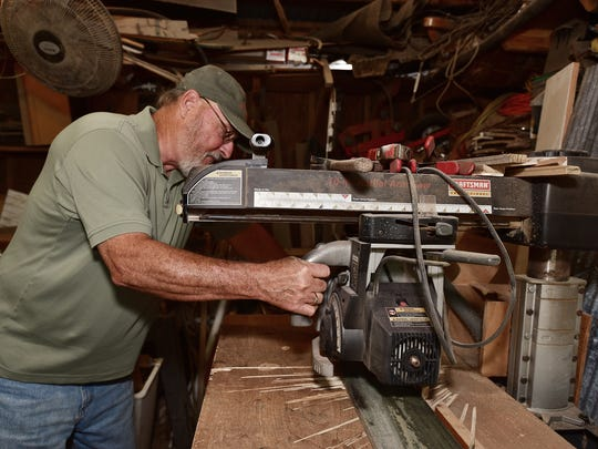 Jim Goolsby at work in his woodshop.