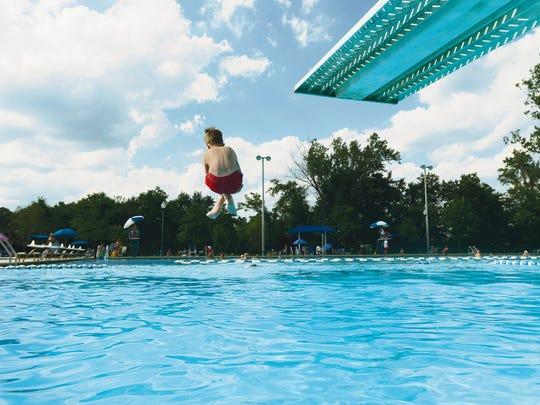 Kids dive in Paramus Municipal pool.