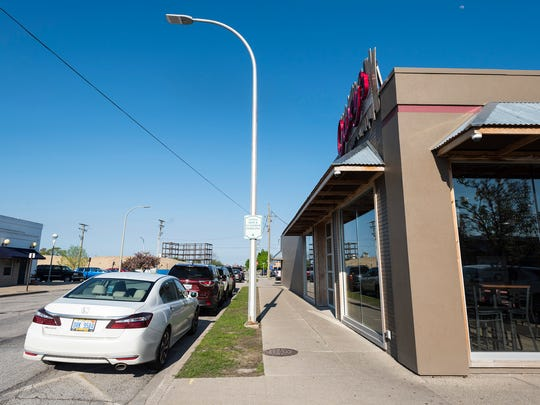 Cars fill the on-street parking off of Beers Street, next to Casey's Pizza on Wednesday, May 23, 2018, in Port Huron. Both on-street parking and in the nearby Greenwood lot tend to be full.