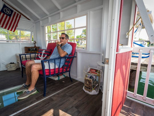 Jim Mittler, of East China, talks Thursday, May 24, while sitting in one of the small houseboats he makes. Last summer Mittler started his business, Tiny Floathouse, which he uses to build and sell the small boats.