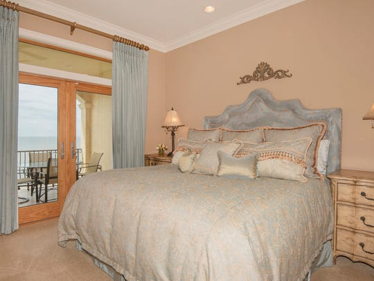 565 Windrose Circle, the master bedroom features a