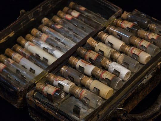 A set of drug vials from the 19th century, part of the Hayes Presidential Library & Museums collection. At one time, some of the medicine kept in them included opium and cocaine.