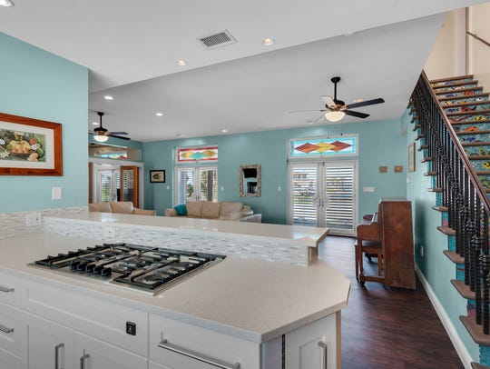 3181 Quiet Water Lane, the kitchen overlooks the living