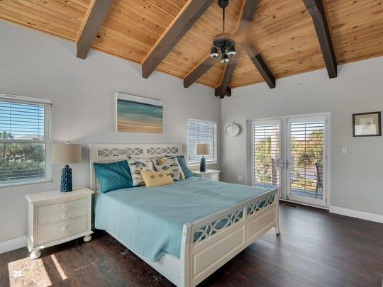 3181 Quiet Water Lane, the master bedroom offers balcony
