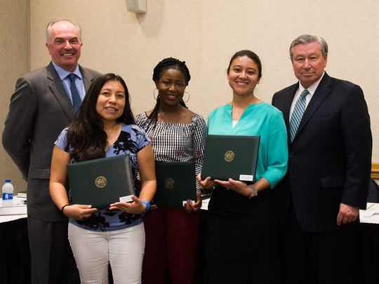 Raritan Valley Community College President Michael J. McDonough, left, and RVCC Board of Trustees Chair Robert P. Wise, right, honor Nursing students, from left, Patricia Sanchez Reyes, Janet Adeleke and Sindy Serrano-Maradiaga, recipients of the College's Service Learning Leadership Award; not pictured are Phebean Messeh and Anyanna Onwumelu.