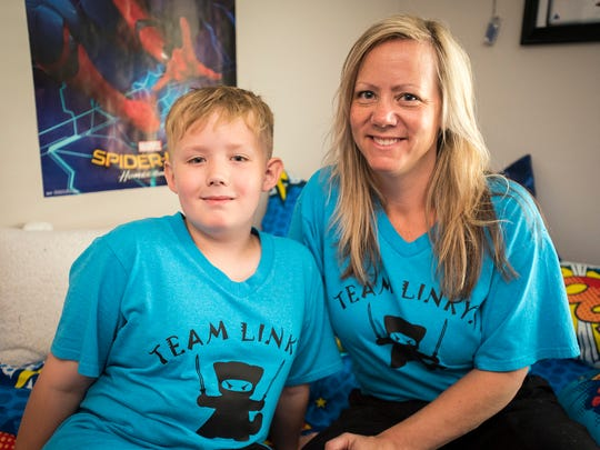Linkyn Oliver, 9, left, pictured with his mother Buffy