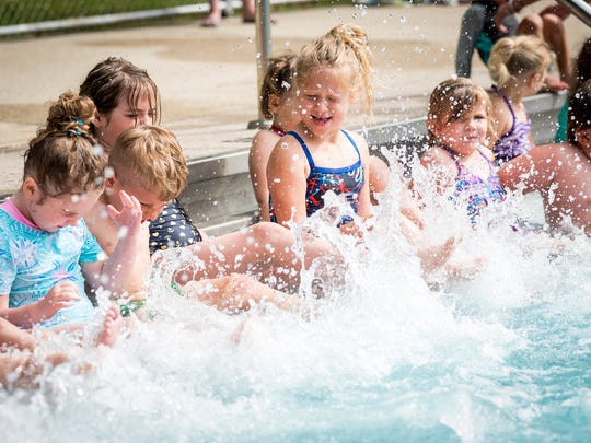 Kids kick their feet in the water Tuesday, June 19, 2018, during a swim lesson at Sanborn Pool in Port Huron.