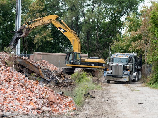 Demolition continues on the former Chicory Warehouse Monday, July 2, 2018 in Port Huron. The warehouse was destroyed last week in a fire.