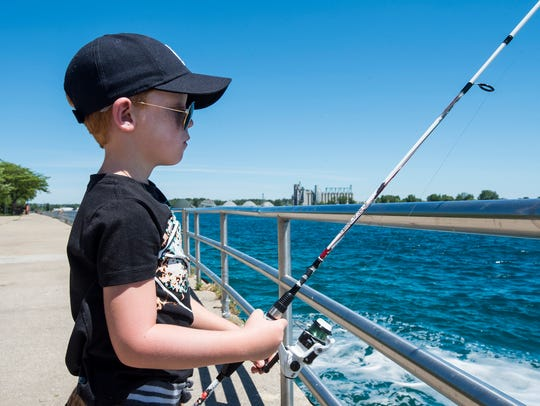 Julian Gladstone, 7, fishes Tuesday, July 3, 2018 along