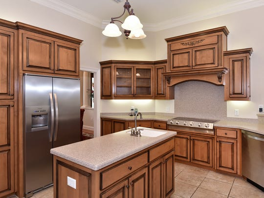 9514 Lucida Lane, the kitchen includes a large island.