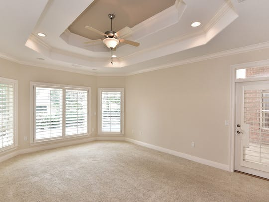 9514 Lucida Lane, the light and bright master bedroom with pool deck access.