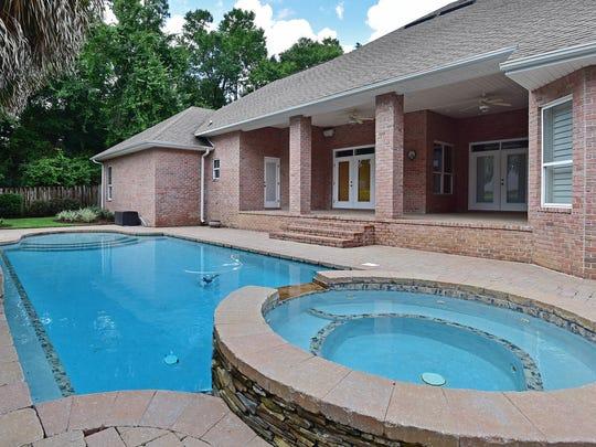 9514 Lucida Lane, the refreshing pool and spa.