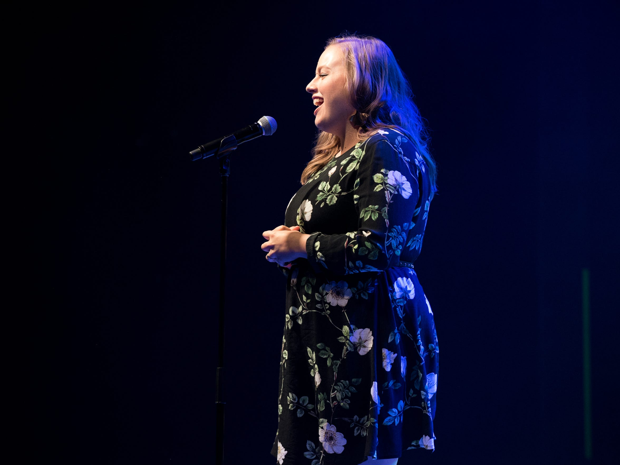 Kaila White introduces the next storyteller  during Arizona Storytellers presents Stories About Stories at The Van Buren in Phoenix on Tuesday, July 17, 2018.