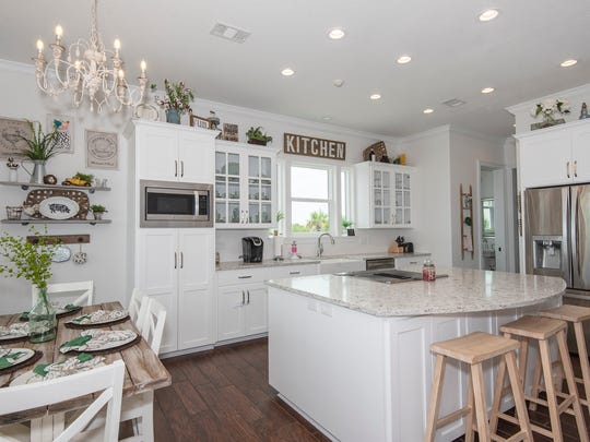 323 Panferio Drive, the open kitchen is perfect when entertaining.