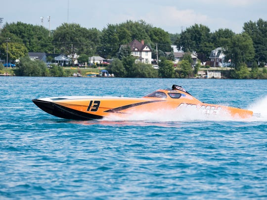 The AMH Motorsports boat does an orientation lap before the start of the Super Cat races Sunday, July 29, 2018 during the St. Clair River Classic Offshore Powerboat races.