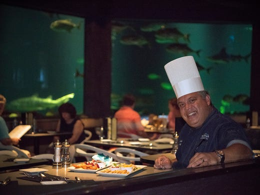 Chef Hector Colon prepares sustainable seafood dishes