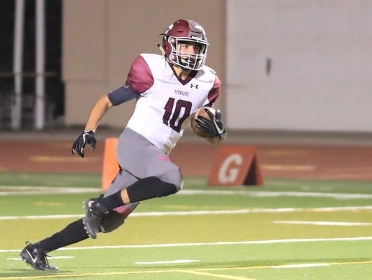 Mt. Whitney's Zack Reza runs against Tulare Western