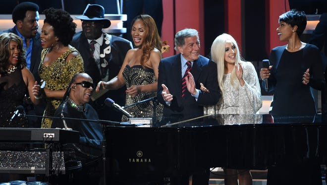 """Stevie Wonder (at piano) is joined by guest performers including Tony Bennett (third from right), Lady Gaga (second from right) and Jennifer Hudson (far right) during the finale at """"Stevie Wonder: Songs in the Key of Life — An All-Star Grammy Salute,"""" at the Nokia Theatre L.A. Live on Tuesday, Feb. 10, 2015, in Los Angeles."""