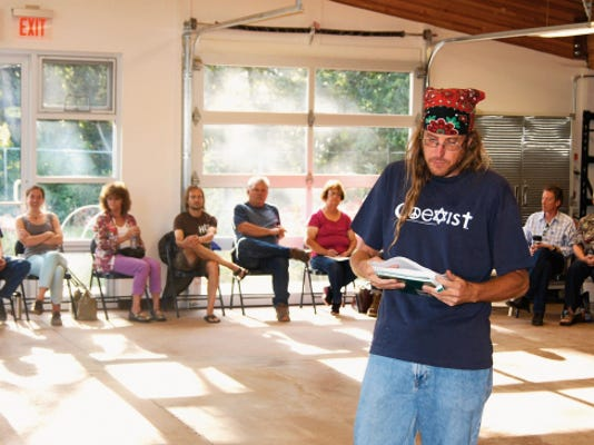 """Jason Burke, director of It Takes A Village, moderates Thursday's """"Great Conversation"""" on homelessness at the Volunteer Center. A committee will meet tonight at 6 p.m. to begin working on a proposed """"safe space"""" for the homeless. Randal Seyler — Sun-News"""