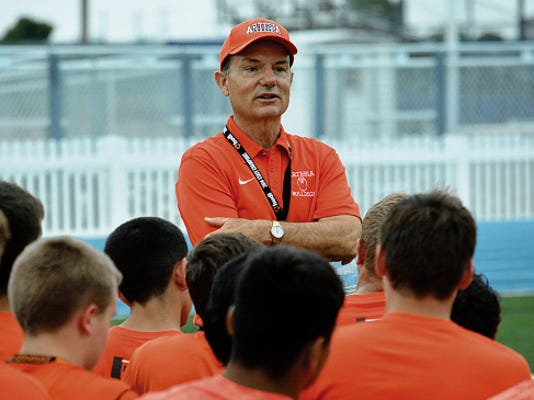 Matt Hollinshead — Current-Argus Artesia coach Cooper Henderson talks to his team after a 7-on-7 scrimmage Tuesday, July 7 at Carlsbad. The Bulldogs open the 2015 season at 7 p.m. tonight at Belen.