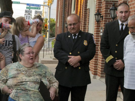 Barbara Rosario, left, and her husband, Jose, far right, join with local emergency responders and family members to recall the April night when responders saved Jose's life. Five EMTs and a paramedic were awarded Clinical Save Commendations during Monday's Chambersburg Borough Council meeting.