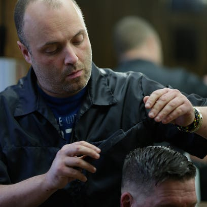 Buddy Lee Brass works on a haircut for Green Bay resident