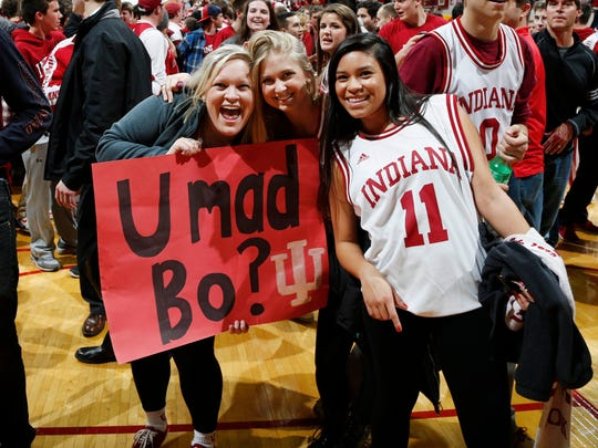 Indiana Hoosiers fans celebrate on the floor after the victory against the Wisconsin Badgers at Assembly Hall. Indiana defeats Wisconsin 75-72.