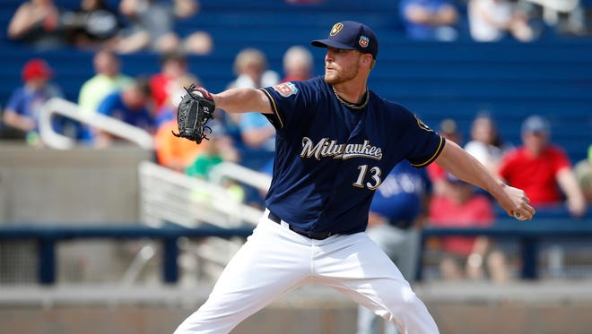 Mar 11, 2016: Milwaukee Brewers relief pitcher Will Smith (13) throws in the third inning during a spring training game against the Texas Rangers at Maryvale Baseball Park.