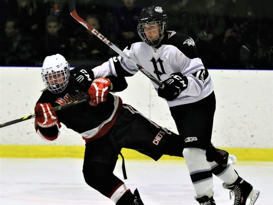 C.J. Mullenax (right) of the Plymouth Wildcats is shown during a 2016-17 game. He is part of the team's No. 1 forward line, with Jack Chumley and Tim Baldwin.