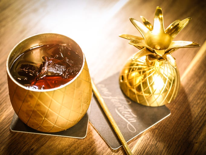 A proper Mai Tai is served in a brass pineapple complete
