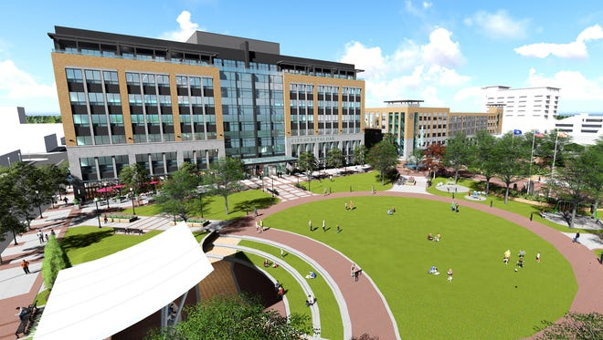 """A rendering of the proposed Royal Oak City Center building and """"Central Park."""" The park would replace the current city hall and police building."""