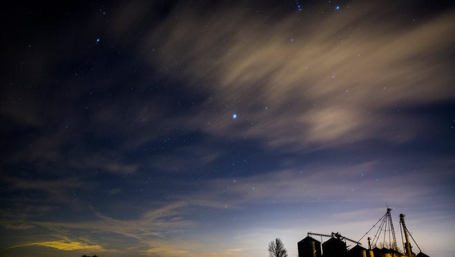 Stars and a distant neighborhood light up the sky in a rural area near Gaston Thursday night.