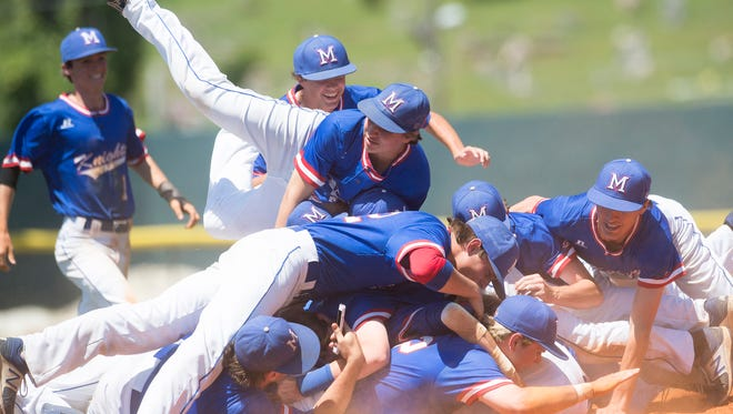 Macon East dog piles after winning the AISA Class AA State Championship after defeating Clarke Prep 6-0 in the second game of the series on Tuesday, May 9, 2017, at Paterson Field in Montgomery, Ala.