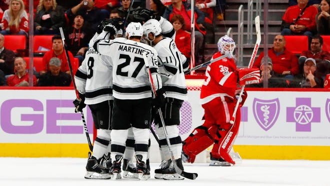 Kings center Anze Kopitar (11) receives congratulations from teammates after scoring in the second period on Tuesday, Nov. 28, 2017, at Little Caesars Arena.