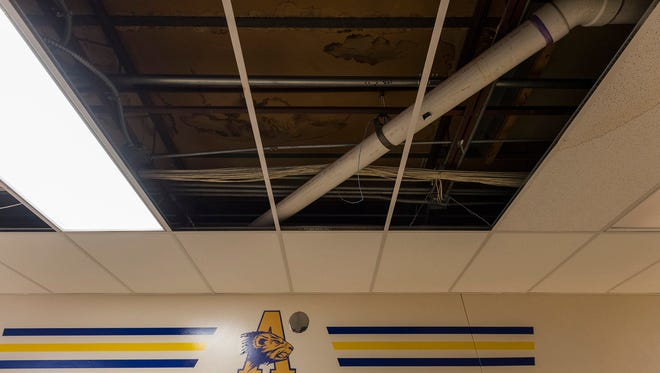 Patches of ceiling tiles have been removed at locations where the roof leaks in the hallways at Algonac Elementary School. The tiles are removed to prevent them from absorbing water and collapsing.