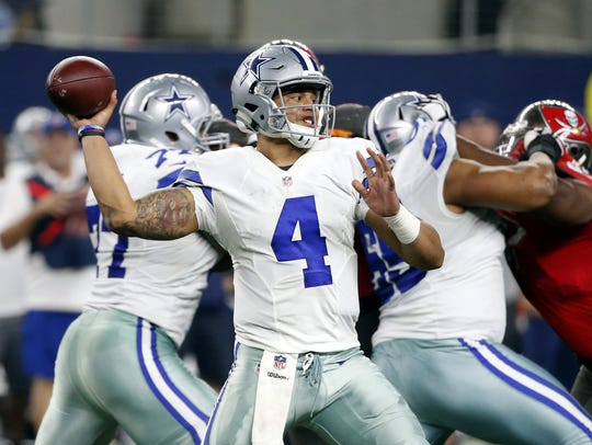 Dallas Cowboys quarterback Dak Prescott (4) throws