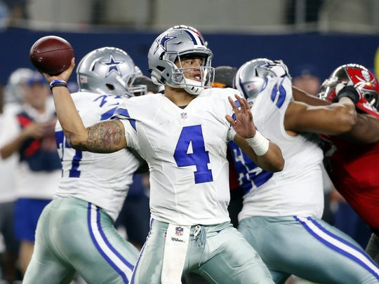Dallas Cowboys quarterback Dak Prescott (4) throws a pass in the second half of an NFL football game against the Tampa Bay Buccaneers on Sunday, Dec. 18, 2016, in Arlington, Texas.