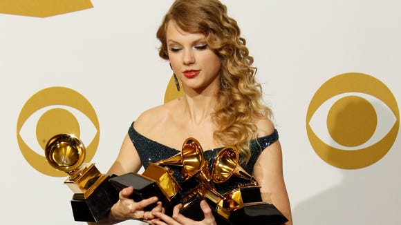 Holding all of those Grammys can be tough.