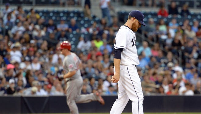 Padres starting pitcher Ian Kennedy reacts after giving up a second-inning home run to Jay Bruce (background).