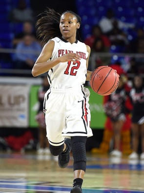 Shawnta Shaw (12) dribbles down the court as Pearl-Cohn