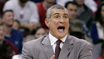 South Carolina coach Frank Martin talks to his players during the second half of an NCAA college basketball game against Kentucky on Saturday, March 1, 2014, in Columbia, S.C. (AP Photo/Mary Ann Chastain)