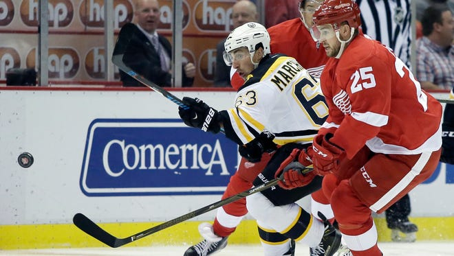 Bruins left wing Brad Marchand (63) races Red Wings defenseman Mike Green (25) to the puck during the first period of the Wings' 1-0 loss Saturday at Joe Louis Arena.