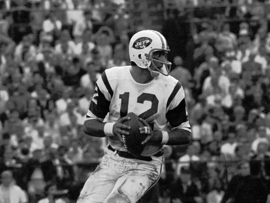 New York Jets quarterback Joe Namath (12) drops back