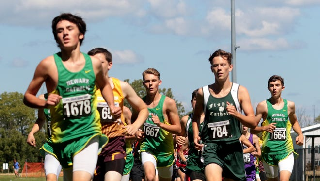 Newark Catholic freshman Pierce Ormond leads his pack in the Division III race Saturday during the McGowan Invitational at Watkins Memorial.
