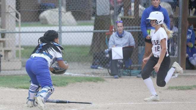 Boonville senior catcher Alexis Trigg prepares to tag Osage's Shelby Miner on a play at the plate in the fifth inning Tuesday night in Tri-County Conference action at Bill Simmons field. The Lady Indians defeated Boonville 5-3.