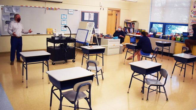 At the Alfred S. Letourneau Elementary School in Fall River, Superintendent of Schools Matt Malone talks about health and safety measures with teachers in a socially distanced classroom. [Herald News file photo | Colin Furze]
