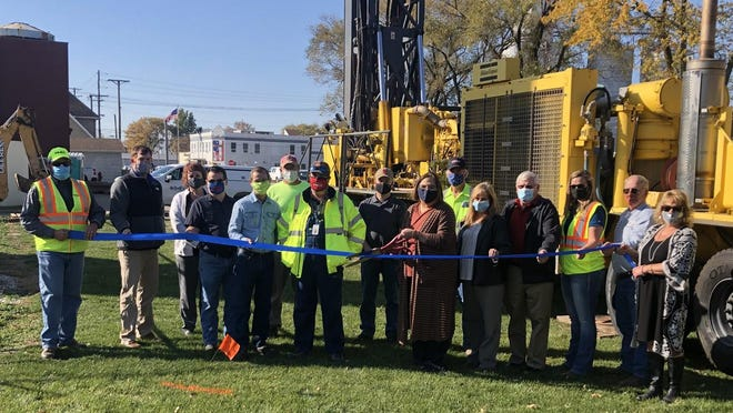 A ribbon cutting ceremony featuring Bushnell city employees, IMEG executives, and WIRC representatives officially welcomed the construction of a deep municipal water well.
