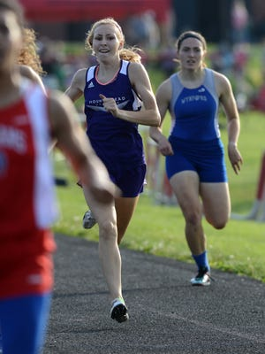 Mount Gilead's Jenna Shipman runs in the girls 400-meter dash Friday night at the Division III Regional Track and Field Finals at Fairfield Union High School in Rushville. Shipman will compete in three events this weekend at the state meet.