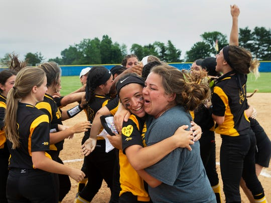 St John Vianney head coach Kim Lombardi celebrates their NJSIAA title with her players. St John Vianney defeats Donovan Catholic 2-0 in Non-Public South A softball final in Sewell, NJ on May 31, 2018.