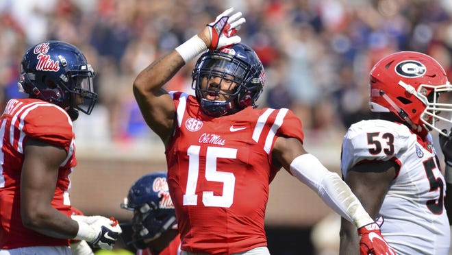 Sep 24, 2016; Oxford, MS, USA; Mississippi Rebels defensive back Myles Hartsfield (15) makes the Landshark sign after a play during the second quarter of the game against the Georgia Bulldogs at Vaught-Hemingway Stadium. Mandatory Credit: Matt Bush-USA TODAY Sports ORG XMIT: USATSI-270116 ORIG FILE ID:  201609_24_szo_mb6_066.JPG